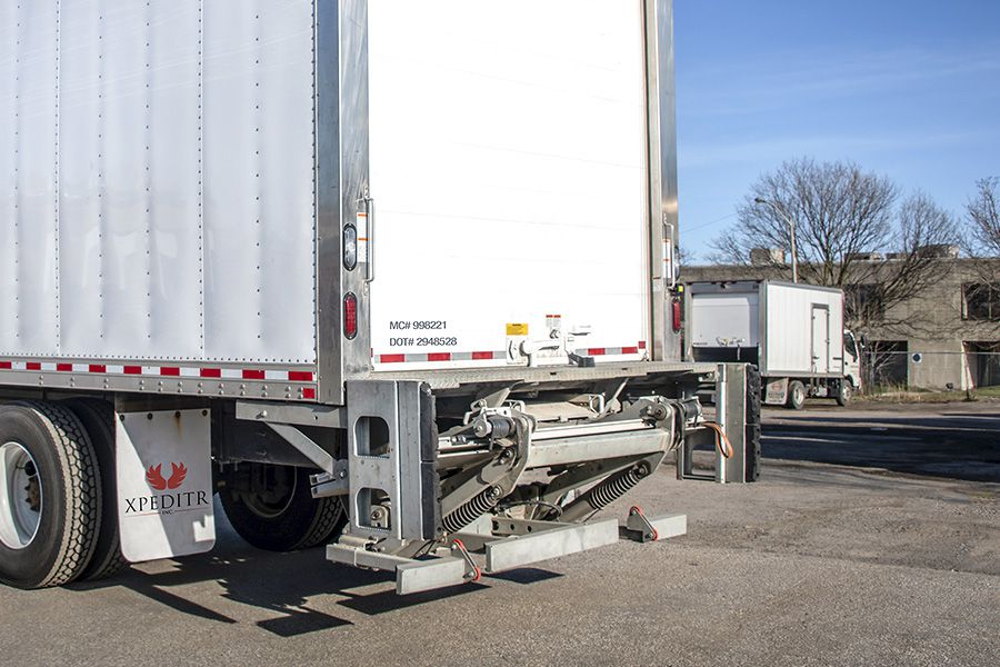 The lift gate for an Xpeditr winery shipping truck